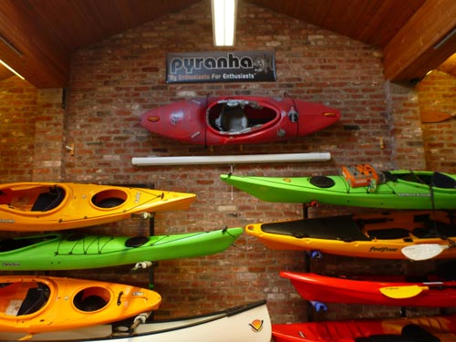 A wall display at Kayaks North West, the original home of Pyrahna and P&H Sea Kayaks