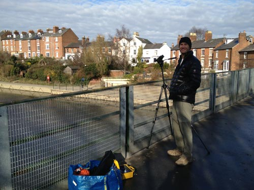 Bryant sets up on a bridge to film rolling action below.
