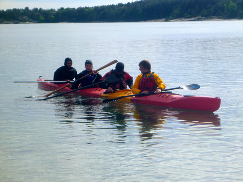 The on-water show ended with Nigel, Nicolai, me and Adam Hanson rolling a four person kayak.