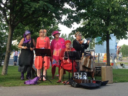 A lively group of ladies show their musical talent in Orsa.