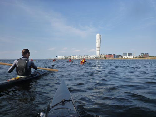 Participants paddle back to the launch with Malmo's spectacular architecture as a backdrop.