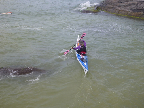 Lotta demonstrates directional control of her kayak.