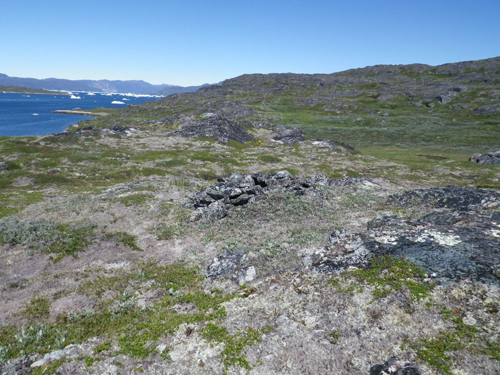 This pile of rocks is an Inuit grave. Over time many of these graves have opened up, revealing bones from long ago.