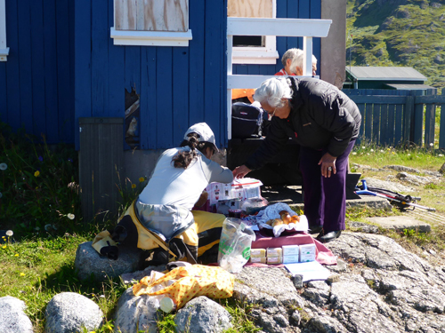 We visited active villages as well. Here Gennifer buys pastries from an Inuit woman in Narsaq.