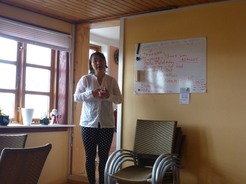 Heidi teaches Greenlandic during breakfast at the hostel.