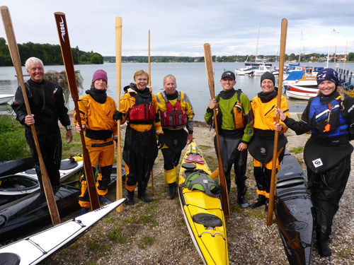 A happy group of paddlers and their sticks.