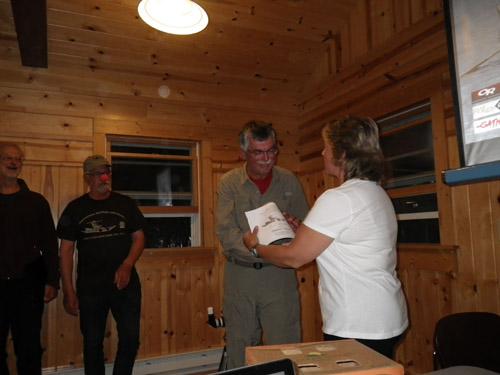 Last year's harpoon winner hands presents this year's harpoon winner with his award. Congrats Kirt!
