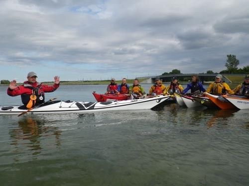 Mark talks about strokes with the local kayaking club.
