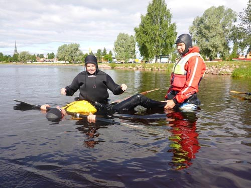 "Participants work on their rolls using the ""Human Kayak Method."""