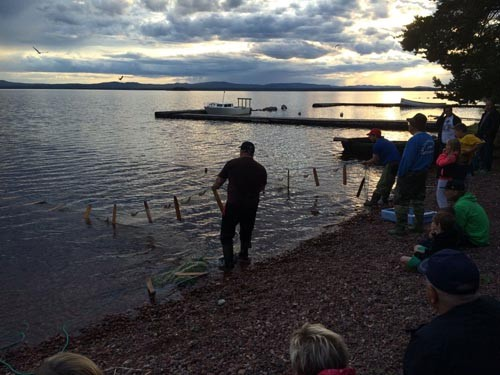 Part of the art show included watching fishermen use nets to attempt to catch a very special fish called VWVWV.
