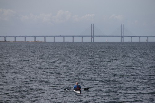 Mark takes a break while looking at Oresund Bridge, the bridge that connects Sweden and Denmark.